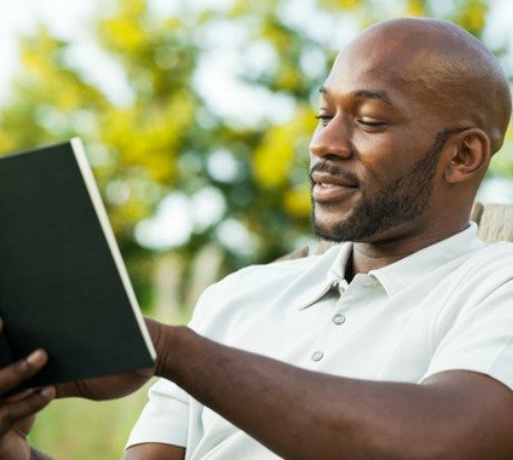 https://thereadywriters.com/wp-content/uploads/2021/02/african-american-man-reading-feat.jpeg